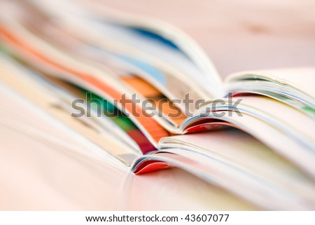 Stack of open magazines isolated - stock photo