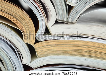 stack of opened magazines background texture