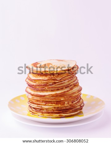 Stack of pancakes on a plate isolated on white background. Selective focus.