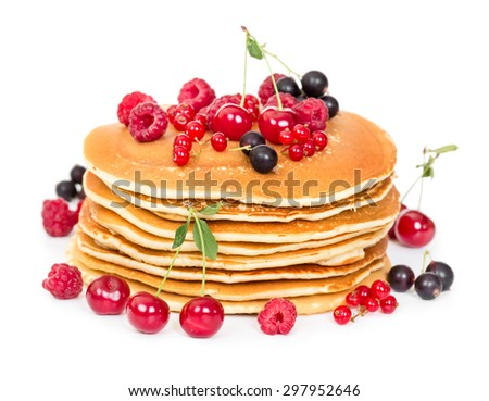 Stack of pancakes with berries isolated on white background