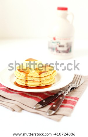 Stack of pancakes with marple syrup and butter - stock photo