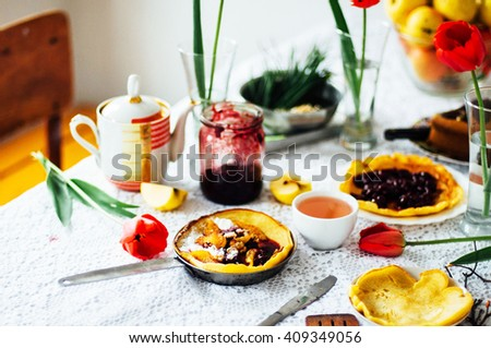 Stack of pancakes with red cherry jam. Pancakes withcherry jam. pancakes or fritters served with cherry jam, delicious dessert for breakfast , rustic style. 