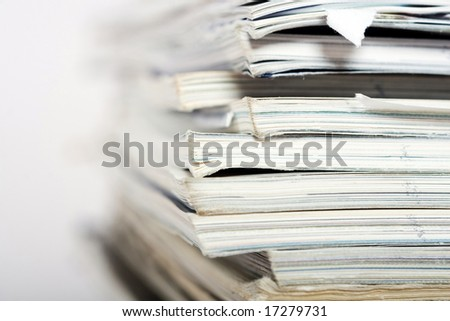 Stack of paper on neutral background closeup