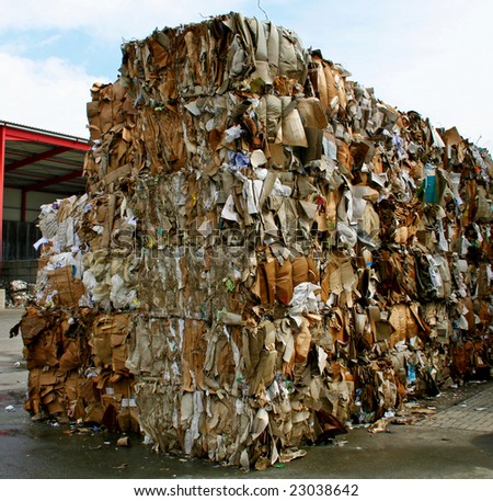 stack of paper waste before shredding at recycling plant in Germany - stock photo