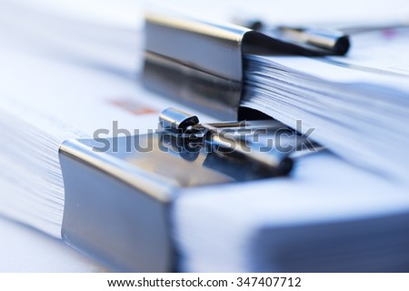 Stack of paper with clip - stock photo