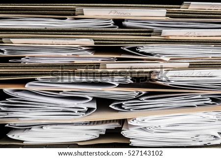 Stack of papers, bills, invoices and financial statements in files
