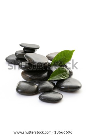 stack of pebbles isolated on white - wellbeing