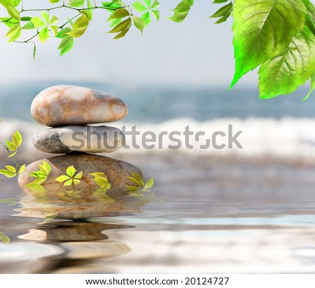Stack of pebbles on sea background - stock photo