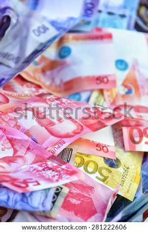 Stack of Philippine pesos with various denominations - stock photo
