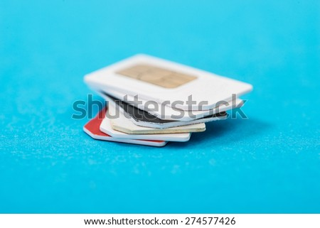 Stack Of Phone Sim Card Over Blue Background - stock photo