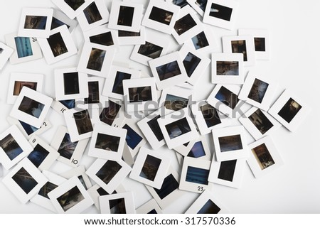 stack of photo slide on white background - stock photo