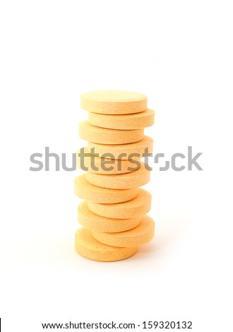 Stack of Pills of vitamin C on white background.  - stock photo