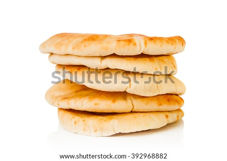 Stack of pita bread on white background - stock photo