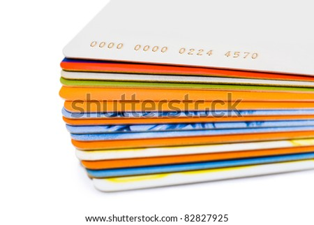 Stack of plastic cards isolated on white background - stock photo