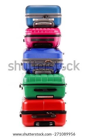Stack of plastic suitcases isolated on white background - stock photo