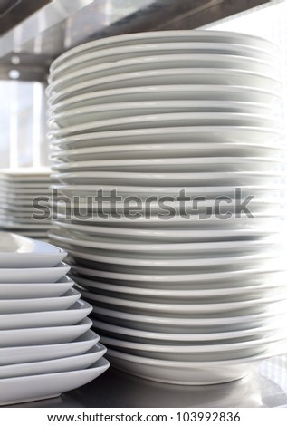 stack of plate  Pile clean side plates - stock photo