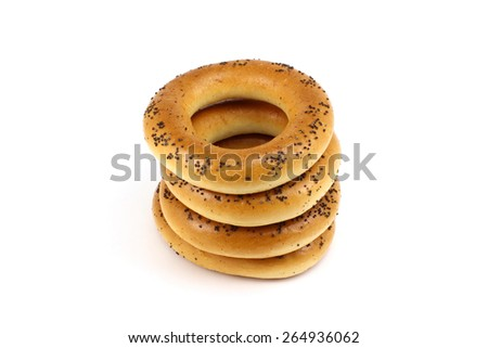 Stack of poppy bagels on a white background - stock photo