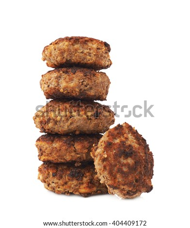Stack of prepared small hand made cutlets isolated over white background - stock photo