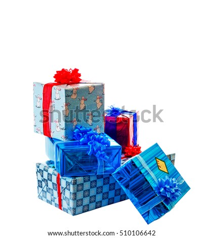 Stack of presents wrapped in bright blue and red colors and tied with colorful ribbons