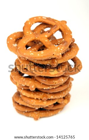 Stack of pretzels on a white background - stock photo