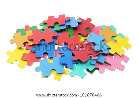 Stack of Puzzle Pieces on White Background - stock photo