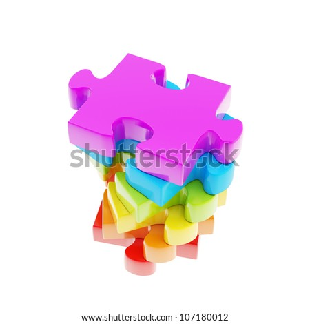 Stack of rainbow colored puzzle jigsaw glossy pieces isolated on white
