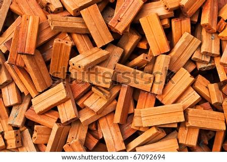 Stack of raw bricks texture - stock photo