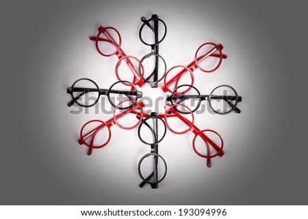 Stack of red and black glasses with vignette - stock photo