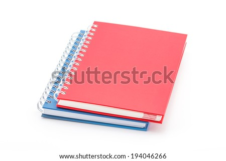 Stack of red and blue color notebooks isolated on white. - stock photo