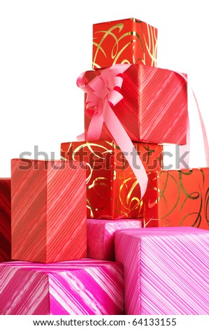 Stack of red and pink gifts on white background. - stock photo