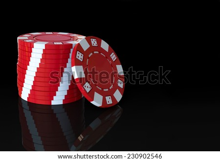 stack of red casino poker chips on a black background and reflective floor - stock photo