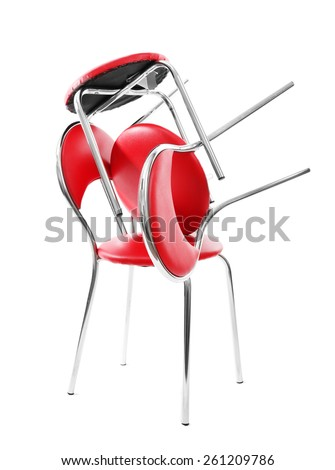 Stack of red chairs isolated on white - stock photo