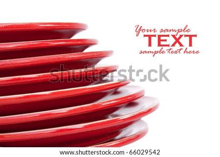 Stack of red saucers isolated on white - stock photo