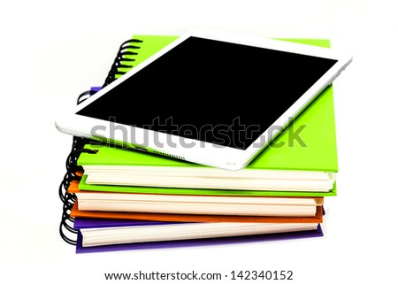 stack of ring binder book or notebook with tablet computer isolated on white - stock photo