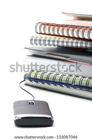 stack of ring binding book with mouse for e-learning Concept - stock photo