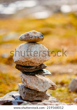 Stack Of Rocks Stones, On Blurred Background, On Norwegian Mountain, Norway Nature. - stock photo
