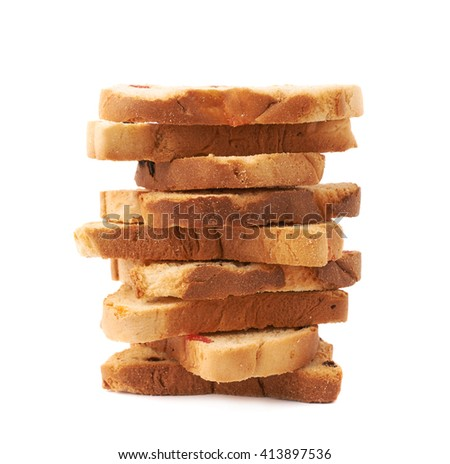 Stack of rusks with the pieces of dried fruits isolated over the white background - stock photo