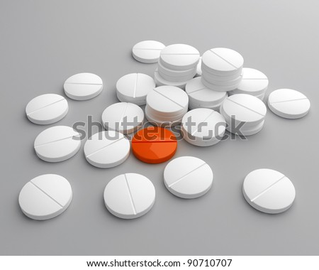stack of scattered pills with orange one in the middle - stock photo