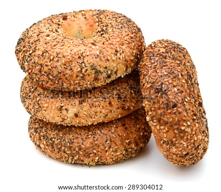 stack of sesame bagels isolated on white background - stock photo