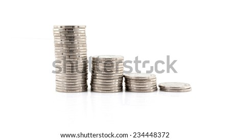 Stack of silver coins isolated on a white background. - stock photo