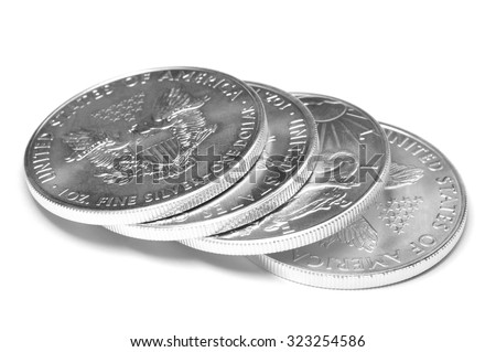Stack of Silver Eagle Coins on White Background - stock photo