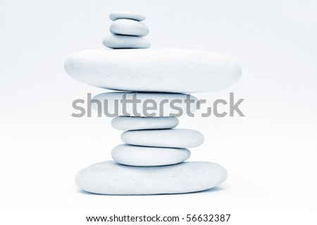 Stack of smooth stones over white background