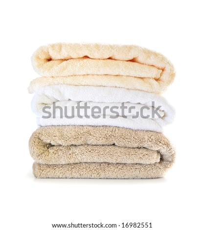 Stack of soft towels isolated on white background - stock photo