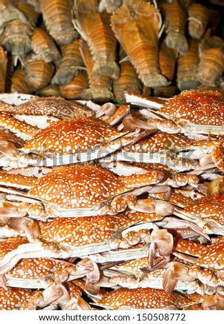 Stack of steamed Sand crab and Mantis shrimp - stock photo