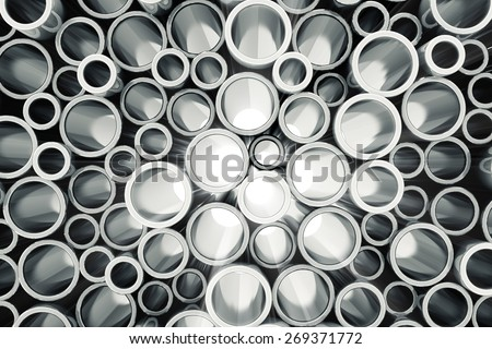 Stack of Steel Metal Tubes with Light Breaking Through a Pipes. Abstract Industrial Background - stock photo