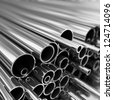 Stack of steel  pipes. - stock photo