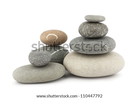 Stack of stones isolated on white - stock photo