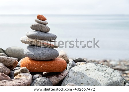 Stack of stones on the coast (beach) of the sea. Natural background. Balance, harmony, health, success, travel concept. Copy space. Empty place for you message. Close up. Outdoor.
