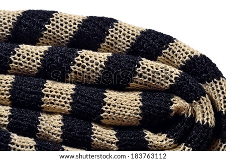 Stack of striped knitted fabric on a white background