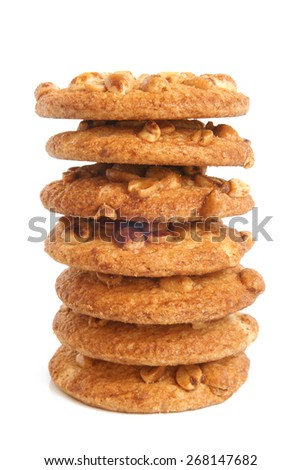 Stack of sugar cookies with peanuts on white background - stock photo